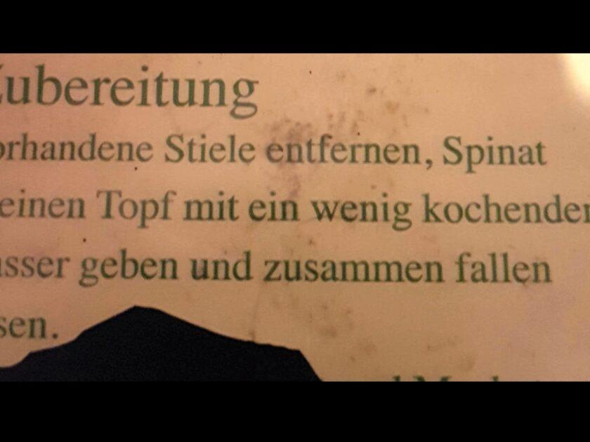 Spinat in Topf geben und zusammen fallen lassen